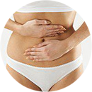 Woman with pain in abdominal area
