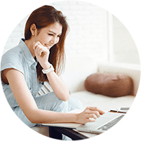 Woman researching a urogynecologist on computer